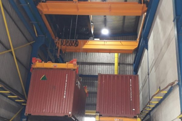 Container Spreader in a Warehouse